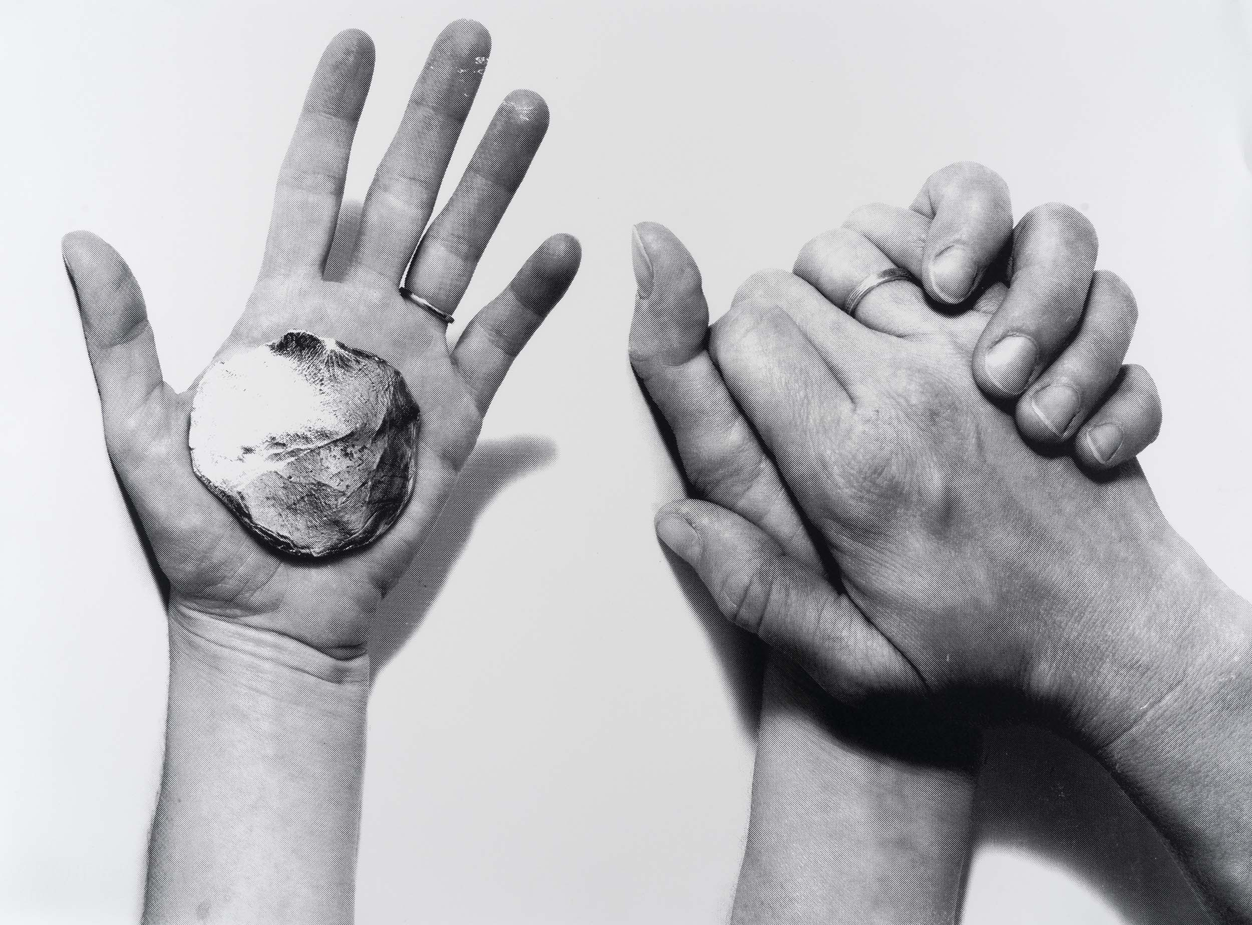 Silkscreen print showing a person's hand holding a small ceramic disk in their palm and two hands folded together at the palm, as if to shape that same disk.