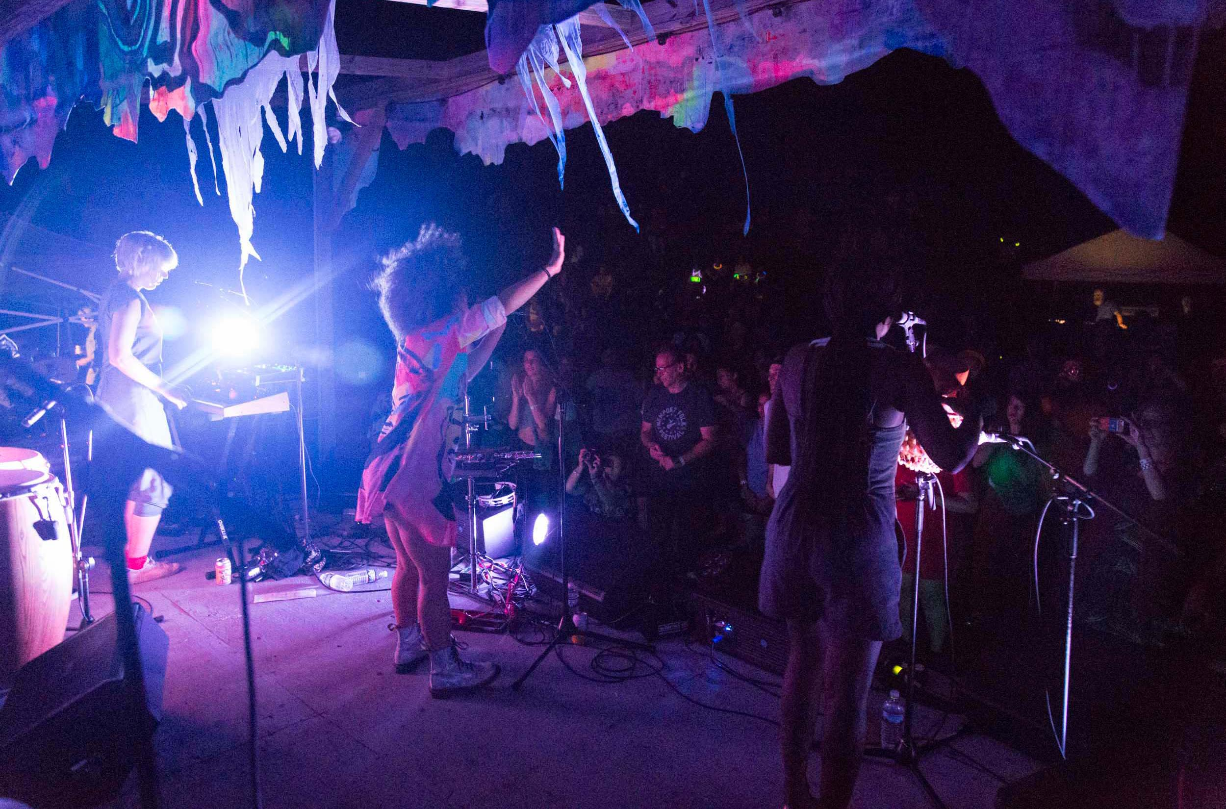 A band plays for an audience of attendees at the Wassaic Project festival.